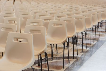 occupied: Row of empty chairs waiting to be occupied