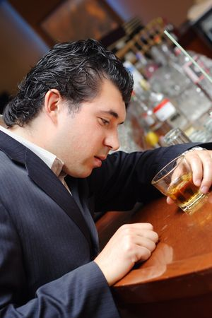 Drunk man in a bar photo