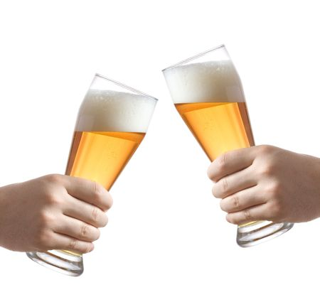 Two people holding  beer glasses against white background