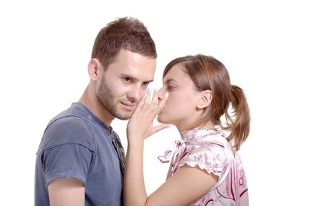 Girlfriend talking to a boyfriend against white background photo