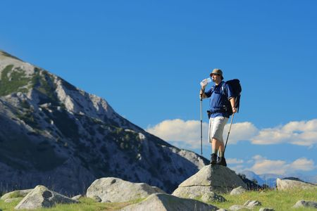 Backpacker standing on a rock in national park Pirin, Bulgaria Stock Photo - 1364438