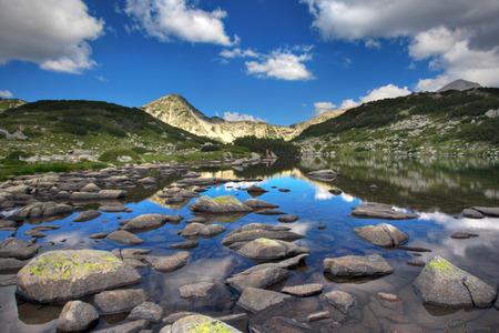 Glacial lake Zabecko with Hvoinat peak at national park Pirin, Bulgaria photo
