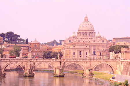 St. Peters Basilica and a bridge on Tiber River, Rome Italy photo