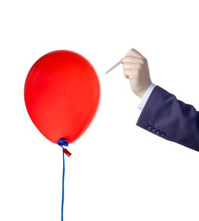 red pin: Balloon burst against white background Stock Photo