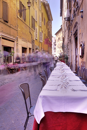 italy culture: Street scene from Rome, Italy depicting a restaurant Stock Photo