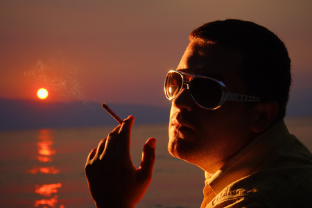 Person with a cigarette in his hand photo