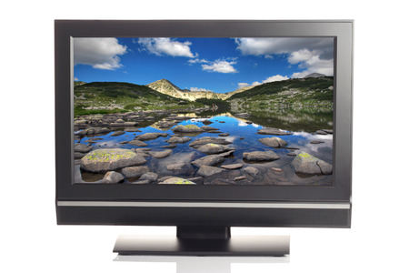 LCD tv displaying a beautiful landscape picture photo