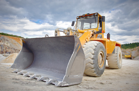 dredging tools: Large bulldozer at construction site