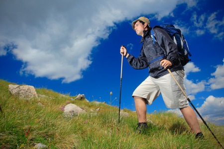 Hiker climbing a peak in national park Pirin, Bulgaria Stock Photo - 1528198