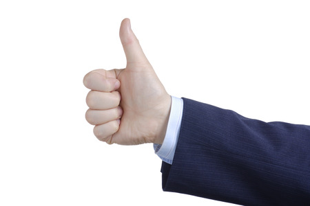 Thumbs up against white background photo