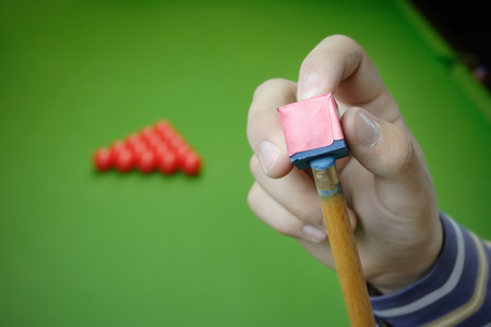 cue sticks: Pool player preparing for a game