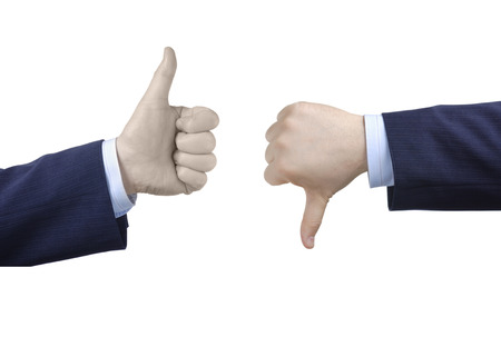 negation: Thumbs up and thumbs down Stock Photo
