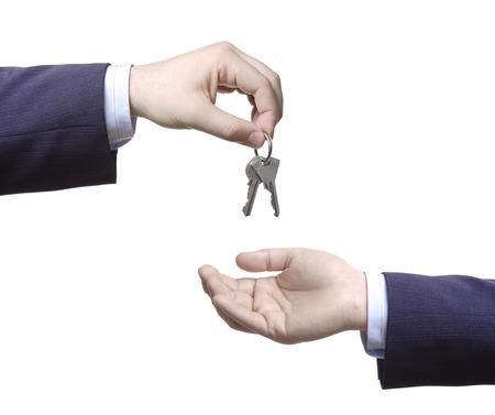 Person passing door keys Stock Photo - 1599771