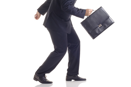 attempting: Businessman with a briefcase attempting to run away