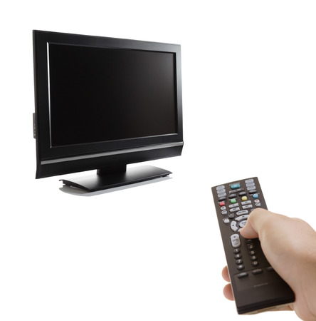 telly: TV set and a person with a remote Stock Photo