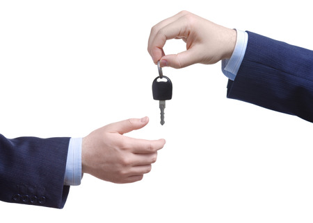 Person passing car keys against white background Stock Photo - 1702874