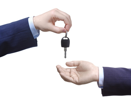 Person passing car key against white background Stock Photo - 1716518