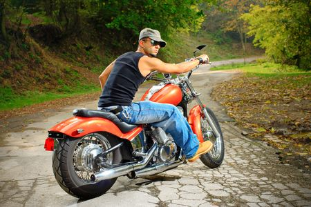 On the road-Biker on a chopper Stock Photo