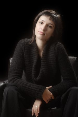 Young woman against a dark background Stock Photo - 2093375