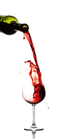 Red wine pouring down from a wine bottle Stock Photo - 2163198