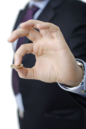 Person in a suit holding a coin in his hand Stock Photo - 2196531