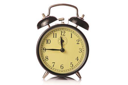 Retro alarm clock against white background photo