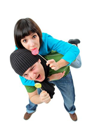 A man and woman with lollipops isolated on white background Stock Photo - 2290162