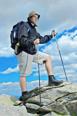 Person climbing a cliff Stock Photo - 2308412