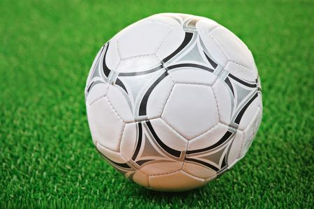Soccer ball against grass background Stock Photo - 2396668