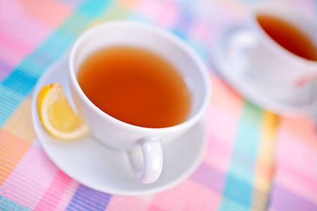 A view of a cup of tea and a slice of lemon photo