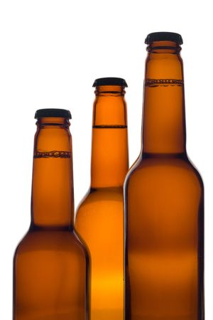 Three beer bottles against white background photo