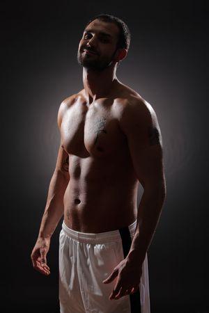 Athlete against black background photo