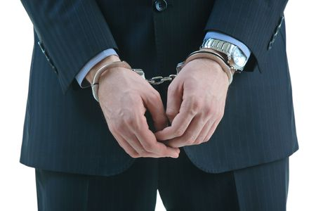 cuffed:  Handcuffed criminal