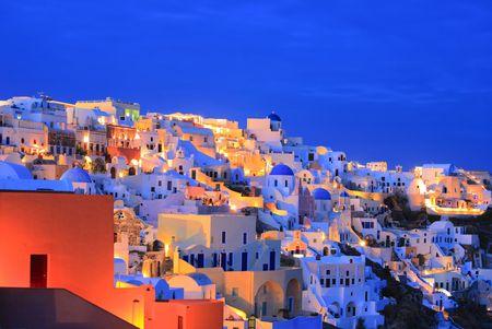 Oia village on Santorini island at nighttime photo