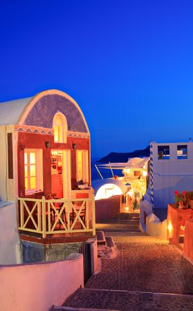 Traditional house in Oia village on Santorini island at nighttime Stock fotó