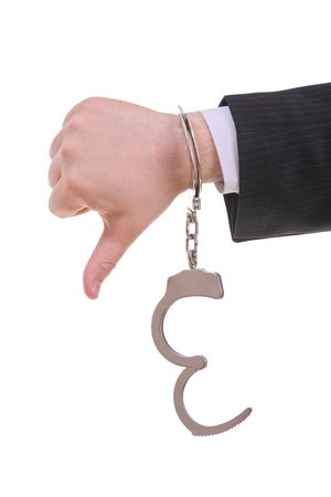 Thumbs down with a handcuffs isolated against white background photo