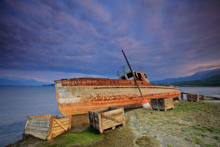 Abandoned boat at Prespa lake, Macedonia photo