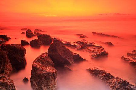 Rocks at sunset on the island of Brac, Croatia photo