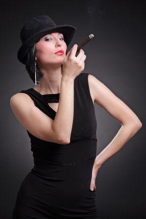 cigar smoking woman: Fashionable young woman with a cigar Stock Photo