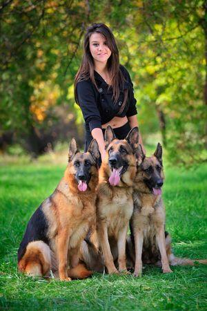 Teenage girl with three German Shepherd dogs