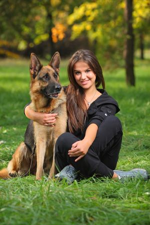 Smiling teenager hugging a German Sheppard dog Stock Photo - 3750414