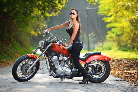 Attractive girl  on a motorbike photo
