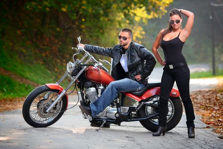woman motorcycle: Biker and an attractive girl Stock Photo