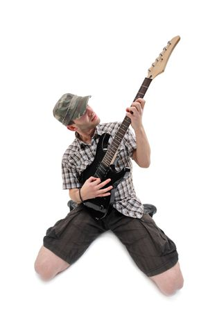 Guitar player isolated against white background photo
