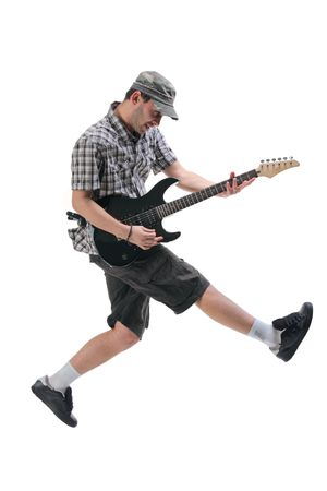dynamic: Guitar player jumping in midair isolated against white background