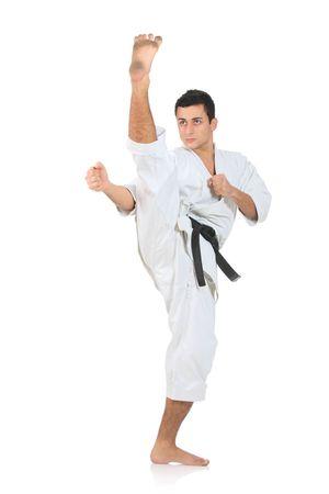 karate kick: Karate man  exercising against white background