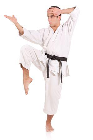 dynamic activity: Karate man isolated against white background Stock Photo