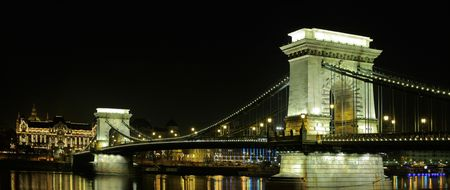 The Royal palace of Buda and the Chain Bridge in Budapest, Hungary by night photo