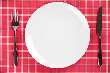 Table setting with an empty plate and fork and knife Stock Photo - 4278612