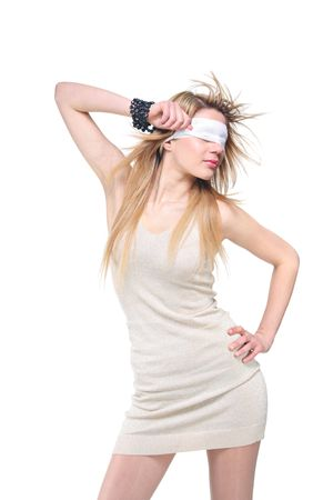 Blindfolded young woman isolated against white background photo